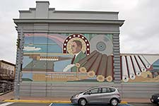 photo- logging history art on building in downtown Fort Frances