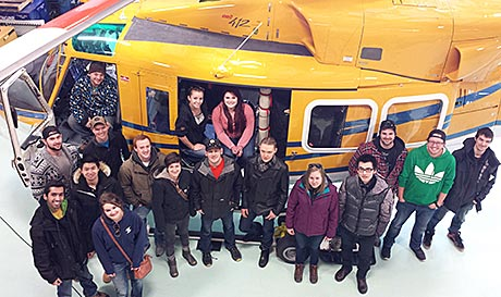 Photo - students at entrance to Wisk Air Helicopters tour group photo