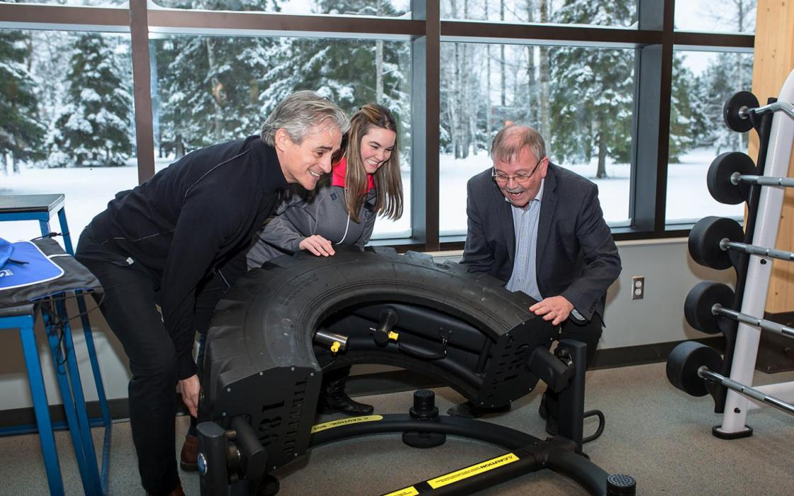 Tire Lift - MPP Bill Mauro, SUCCI President Jodi Afonso and College President Jim Madder