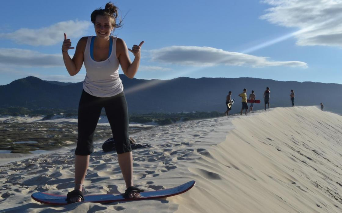 Confederation student Alexa Metsellaar sandboarding in Brazil