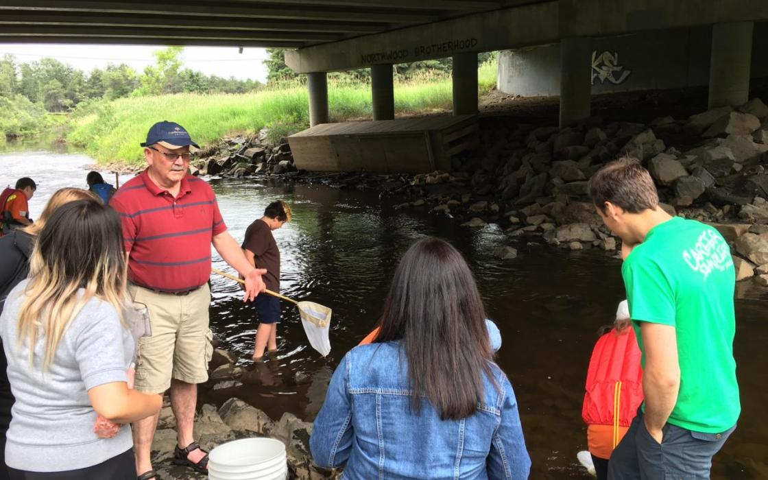 Confederation College President Jim Madder used his knowledge of entomology to talk to students about the city's aquatic life.
