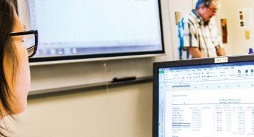 banner photo - student in a computer class