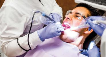 banner photo - polishing client's teeth