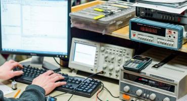 photo - student coding logic at an electronics workstation