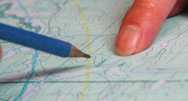 Banner Image - closeup detail working with a map