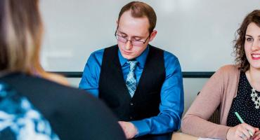 photo - Human Resources Management students conducting a mock job interview