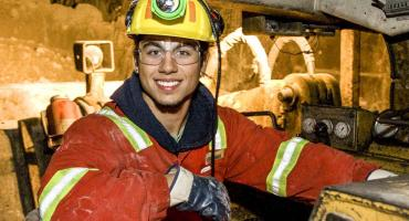 photo - Mining student in scoop tram in a Hemlo gold mine near Marathon, Ontario