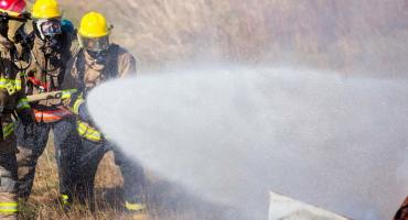 photo - students gain experience with fighting a vehicle fire