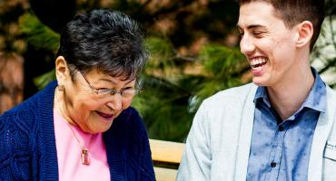 photo - Recreation Therapy student interacting with a senior out for a walk