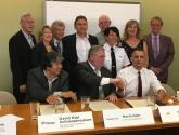 Representatives from 11 major organizations sign the Thunder Bay Anti-Racism & Inclusion Accord