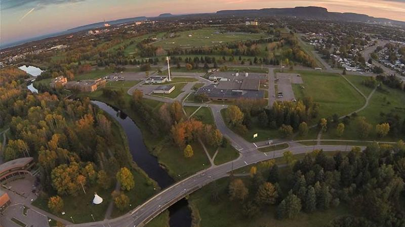 Drone aerial photo of Thunder Bay Main Campus looking south toward McIntyre Building with Mount MacKay in background