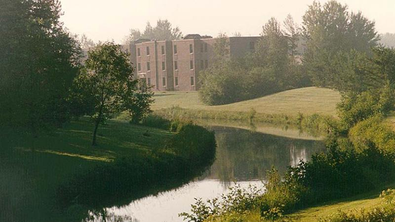 photo - Student Residence by river - in morning fog