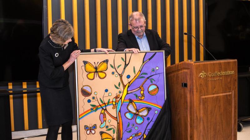 Jim Madder presents Kathleen Lynch with art piece
