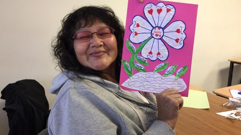 Student Irene Williams Working on a wellness flower
